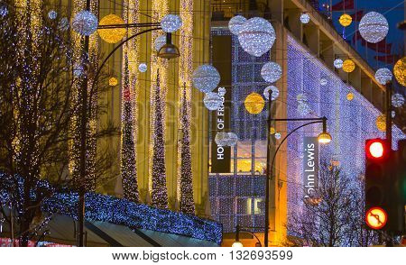 LONDON, UK - DECEMBER 30, 2015: Christmas lights decorations of department's stores in Oxford street