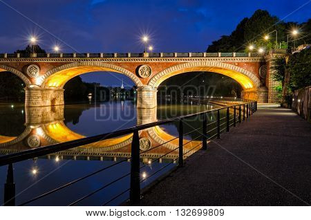 Turin (Torino) Ponte Isabella and river Po at blue hour with Mole Antonelliana in the background