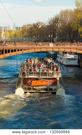 Paris France-April 05 2016: The pleasure boat Jeanne Moreau on Seine river near Notre Dame cathedral Paris France.