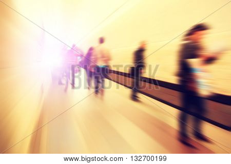 Motion blurred people waiting at subway station.