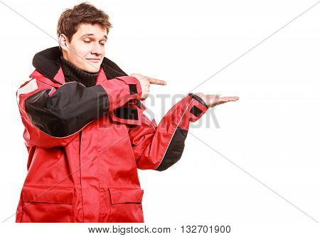 Young male showing gestures. Man wearing weatherproof coat. Communication adventure danger outdoor concept.