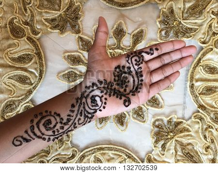 Decorative Henna design on girl's palm. View from above.
