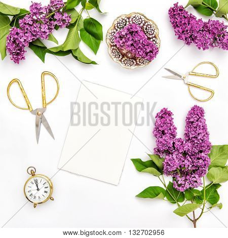Sketchbook lilac flowers office tools and golden accessories. Flat lay spring blossoms