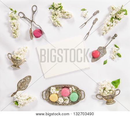 Macaroon french cookies vintage kitchen tools recipe book. Creative food background
