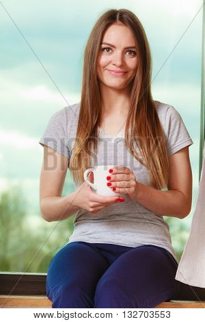 People mornings concept. Beautiful woman drinking morning coffee. Attractive young lady chilling out.