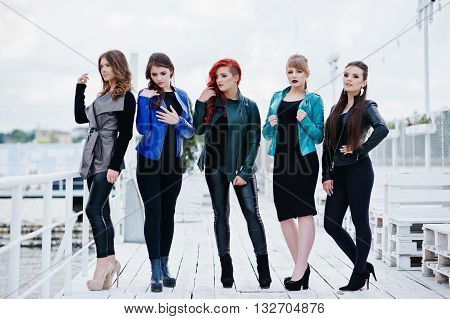 Five Beautiful Young Girls Models At Leather Jackets Posing On Berth.