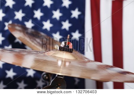 a drums, cymbals, against the backdrop of the American flag