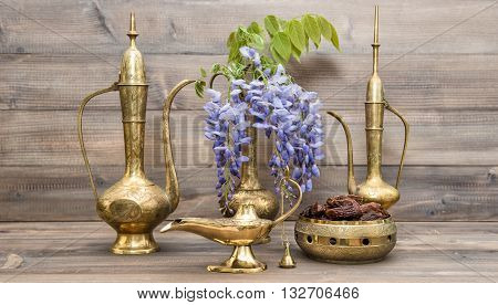 Vintage arabic jug vase lamp tea pot. Fruits and flowers. Golden oriental decorations