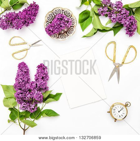 Lilac flowers sketchbook office supplies. Flat lay background top view