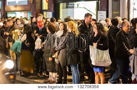 LONDON, UK - DECEMBER 30, 2015:  Crowd of people at Oxford street during Christmas sale. People walking from shop to shop.