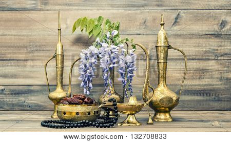 Vintage arabic pots islamic rosary beads. Fruits and flowers. Oriental holidays decoration. Ramadan kareem Vintage style toned picture