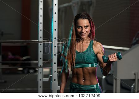Young Woman Working Out Biceps With Dumbbells