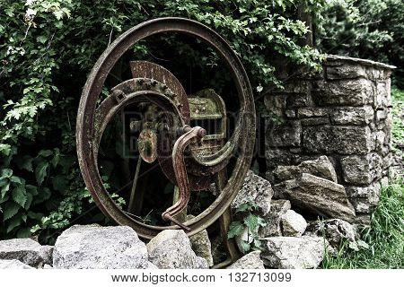A rusty old agricultural farm chaff cutter
