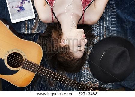 Girl Guitar Earphones Digital Device Lie Down Concept