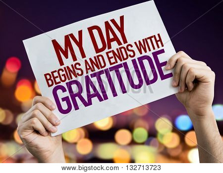 My Day Begins and Ends With Gratitude placard with night lights on background