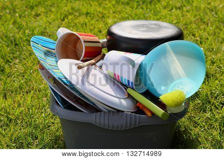 Dirty Plates And Dishes On A Campsite Waiting To Be Washed Up