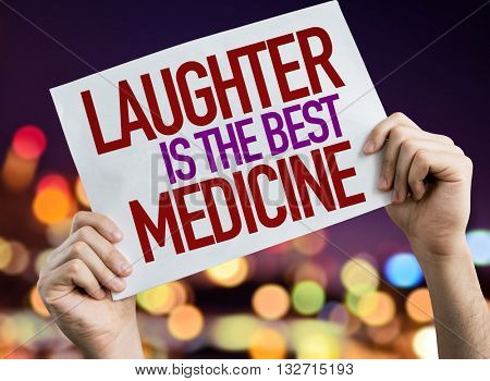 Laughter is the Best Medicine placard with night lights on background