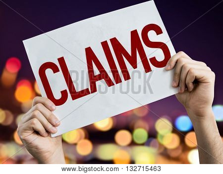 Claims placard with night lights on background