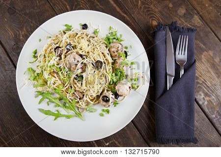 Pasta with meatballs, anchovies and olives. Top view