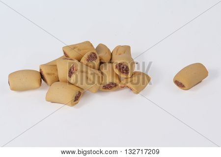 Dog treats piled up on white background.