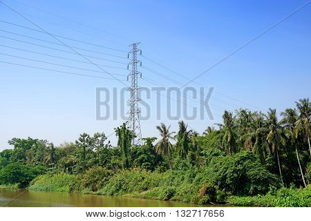 High Voltage Post Or Power Transmission Line Tower And Blue Sky