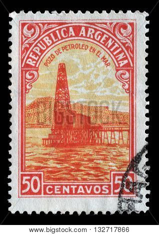 ZAGREB, CROATIA - SEPTEMBER 18: A stamp printed in Argentina shows Oil well, circa 1936, on September 18, 2014, Zagreb, Croatia