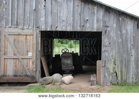A tractor sits in a barn in Port Oneida Rural Historic District, Sleeping Bear Dunes National Lakeshore, Michigan