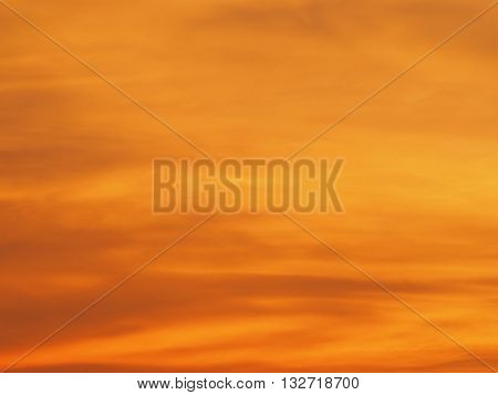 Blur beautiful bright orange sky at sunset sunrise background. Abstract orange sky. Dramatic golden sky at the sunset background.