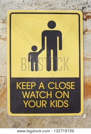 Keep a close watch on your kids sign on the wall