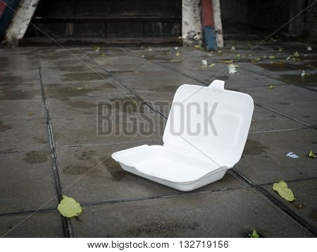 Styrofoam waste on road. Styrofoam waste from foam box for takeaway food make road dirty. Environment problems concept.