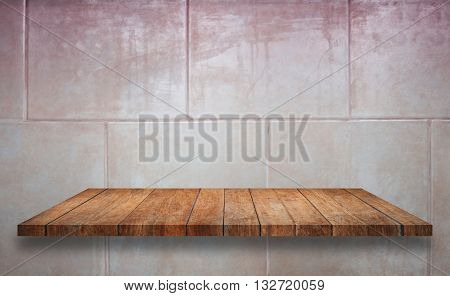 Top of wooden shelf on ceramic tiles wall texture background, stock photo