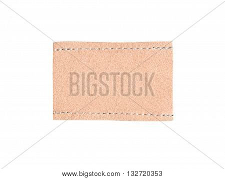 Brown leather tag label with seam isolated on white background.