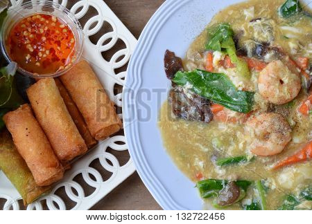 deep fried spring roll and shrimp rice noodle in gravy sauce