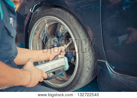 Checking Car Suspension And Tire Pressure