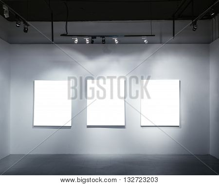 Mock up Blank Posters on wall with Spotlight Art Gallery display