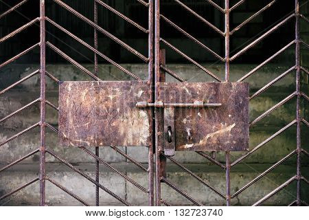 Metal rusty gates with latch and old stairs