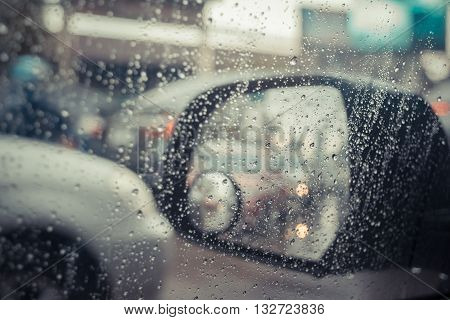 Car Side Mirror And Rain Water Drops