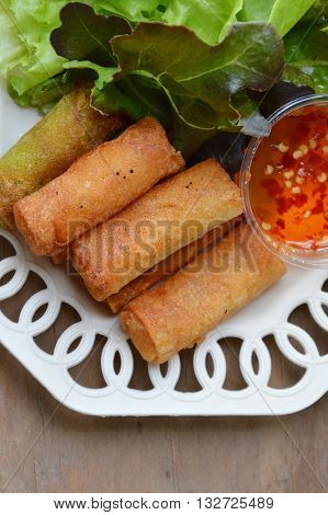 deep fried spring roll and sweet chili sauce on dish
