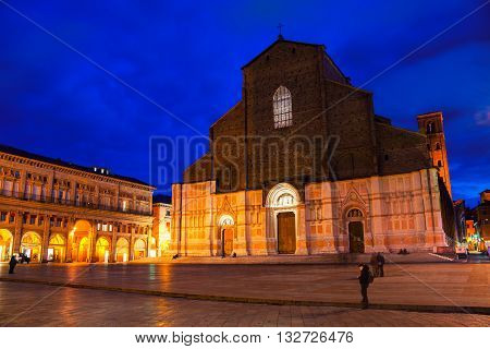 Basilica of San Petronio at the main square of Bologna, Italy. Famous landmark at sunset at night