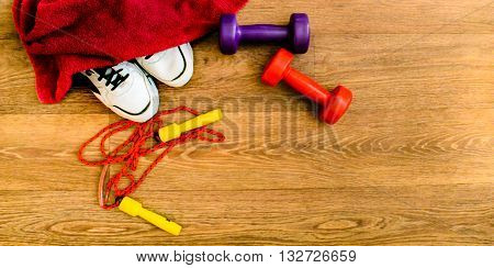 sport equipment, rope, fitness, sports, towel, sneakers, wooden floor, running shoes, sports dumbbells, sport stuff
