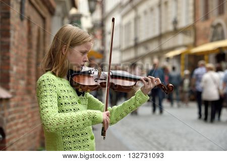 VILNIUS, LITHUANIA - MAY 21: Unidentified young musician play violin in Street music day on May 21, 2016 in Vilnius. Its a most popular event on May in Vilnius, Lithuania