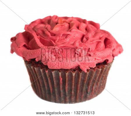 Single red velvet muffin with pink rose cream topping isolated on white background
