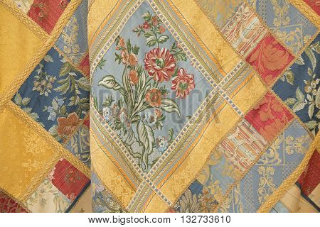 Naples Italy. May 29 2016: detail of silk fabric produced in San Leucio Caserta Italy famous all over the world for its silk factories. This fabric is exhibit to commemorate the three hundredth anniversary of the birth of Charles of Spain who was King of