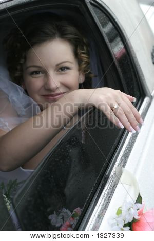 Young Bride Smile In A Limousine
