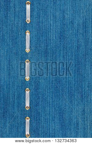 Fashionable background white satin ribbon inserted in denim with space for your creativity