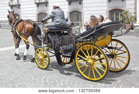 Naples, Italy. May 29, 2016: Participants of the parade of traditional carriages with actors in historical costumes to commemorate  the three hundredth anniversary of the birth of Charles of Spain who was King of Naples from 1734 to 1759