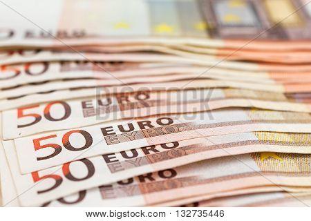 Several fifty euro banknotes stacked. Euro money concept Selective focus.