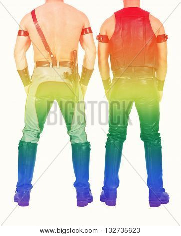 backside of two leathermen dressed in fetish gear with rainbow colors for gay pride