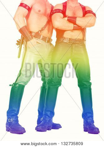 two muscular leathermen dressed in fetish gear with the rainbow colors for gay pride