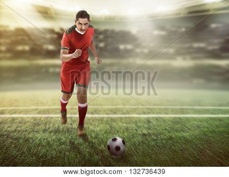 Football Player Dribbling Ball